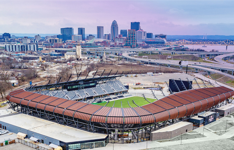 Lynn Family Stadium with colorful skyline in background